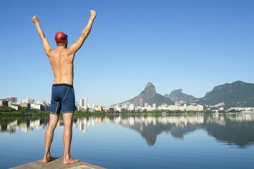 Athlete swimmer standing in front of the Rio de Janeiro skyline at Lagoa Rodrigo de Freitas lagoon