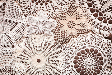 Beautiful delicate vintage lace background of crochet napkins on the table