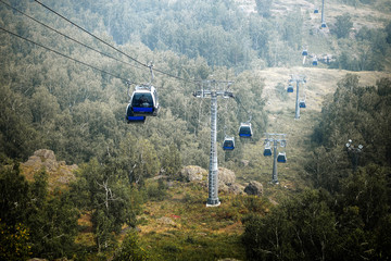 cable car in mountains in summer, ski resort