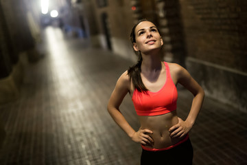 Woman training at night