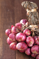 Shallot bundle on wooden table.