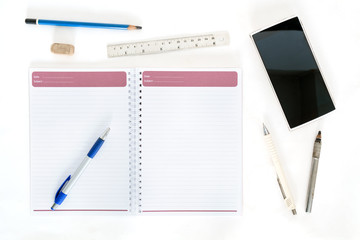 Stationery / Stationery and mobile on white background. Flat lay. Top view.