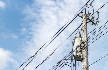 Wooden electricity power pole with wires and transformer, copyspace