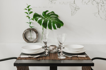 table served with dishes and utensils and glasses