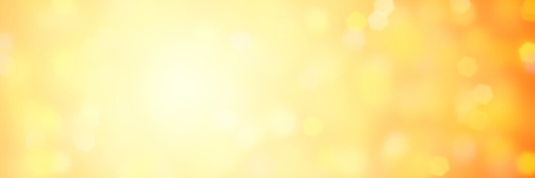 hexagon bokeh banner background in shades of soft yellow and orange