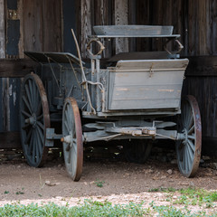 Old horse drawn carriage in a barn