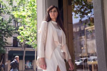 Elegant brunette woman looking away in the street