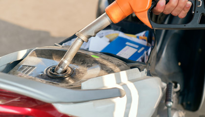Refuel / View of motorcycle refueling at petrol station.