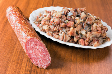 Smoked sausage and herring pieces