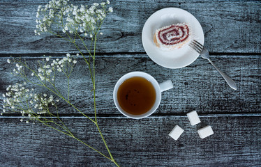 Tea, sweets and flowers