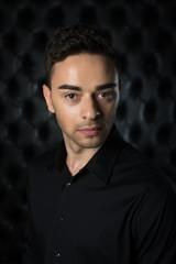 Man portrait on black background