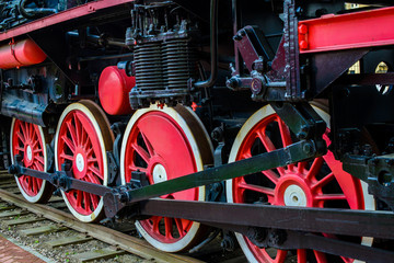 Red train wheels on the rails