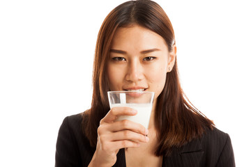 Healthy Asian woman drinking a glass of milk.