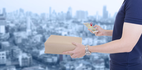 Delivery man carrying parcel delivery of boxes with checking location on tablet ,cityscape background