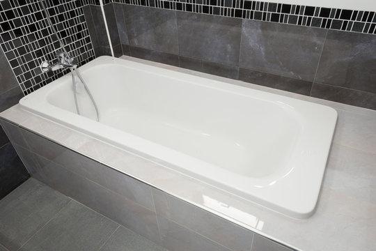 Bathtub white ceramic in bathroom