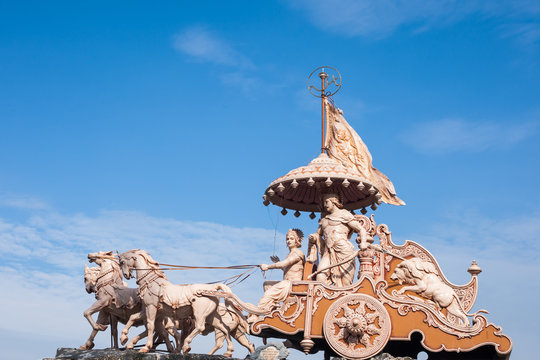A statue of the Hindu god Krishna and his devotee Arjuna at Rishikesh, North India.