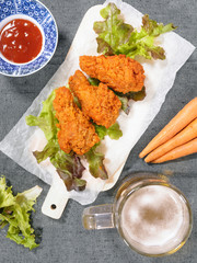 Fried chicken wing with beer and carrot