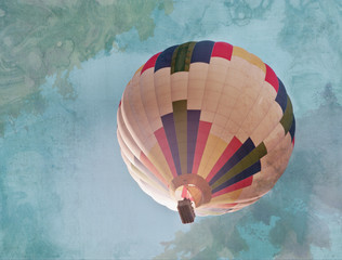 Retro stylized photo of hot air balloon in sky