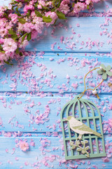 Background  with elegant  pink flowers on blue wooden planks.