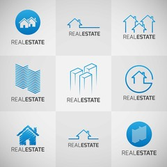 Collection of blue real estate logos