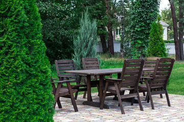 Wooden table and cheers in summer garden