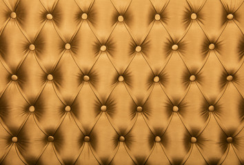 Golden capitone tufted fabric upholstery texture