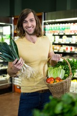 Man holding basket of vegetables