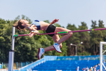 young woman in highjump