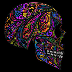 Colored human skull from various patterns on a black background