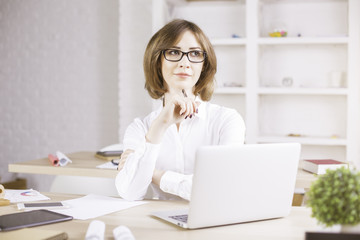 Attractive thoughtful businesswoman portrait