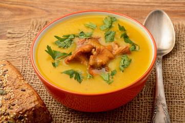 Vegetarian cuisine - cream soup with potatoes and chanterelles mushroom.
