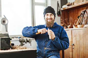 A man working with woodcarving instruments