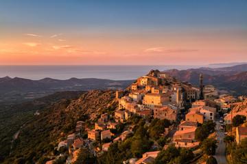 Late evening sunshine on mountain village of Speloncato in Corsi