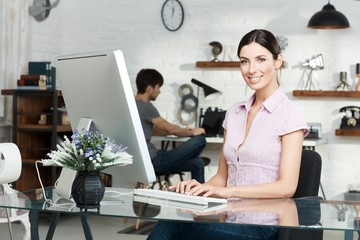 Happy woman working with computer