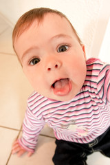 Funny baby showing tongue