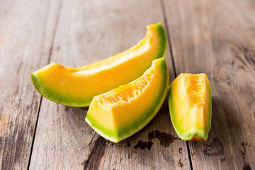 honeydew melon on a wooden table background