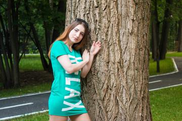 Pin-up model and big tree