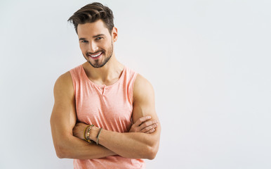 Sexy smiling male model with crossed arms