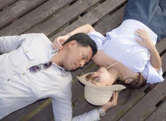 Romantic couple sprawl on wooden bridge 2