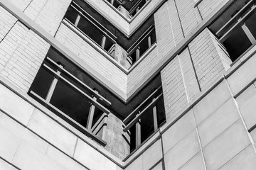 Urban Geometry, looking up to building. Modern architecture black and white, concrete and glass.  Abstract architectural design. Inspirational, artistic image BW. Artistic image and point of view.