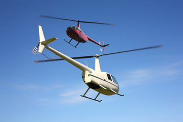 Aircraft - Two small helicopters in flight