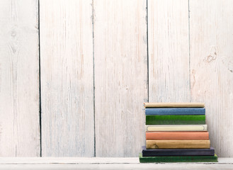 Old Books on Wood Shelf, Spine Cover over White Wooden Wall