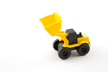 Wheel loader toy isolated on white..