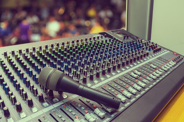Microphone on mixer board.