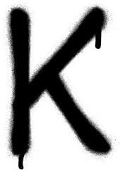 sprayed K font graffiti with leak in black over white