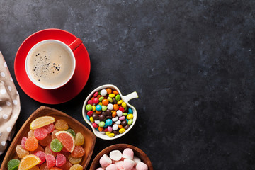 Coffee, colorful candies, jelly and marmalade