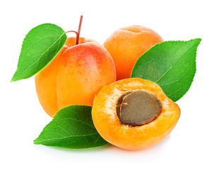 Fresh apricots with leaves close-up isolated on a white background.