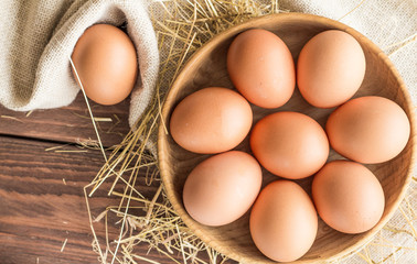 Chicken eggs in a wooden plate on Rushnyk