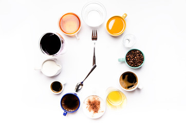 Cups with liquids like a coffee, milk, wine, alcohol, juice stacked in a circle. Clock consist of twelve cups. Time. Alarm clock. Beverages.