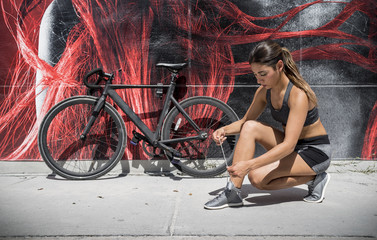 girl preparing for riding her bicycle